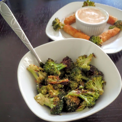Parmesan and Garlic Roasted Broccoli:  A deliciously simple vegetable side of roasted broccoli flavored with parmesan, garlic and a dash of lemon juice.