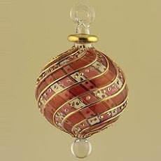 It was a blown glass ornament, claret red and clear glass, fragile and graceful.
