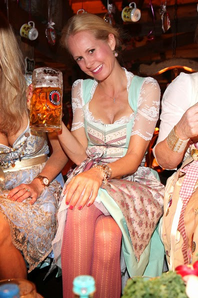 Renata Kochta and Princess Nadja zu Schaumburg - Lippe wearing a dirndl of Coco Vero during Oktoberfest at Kaeferzetl/Theresienwiese on 05.10.2014 in Munich, Germany.