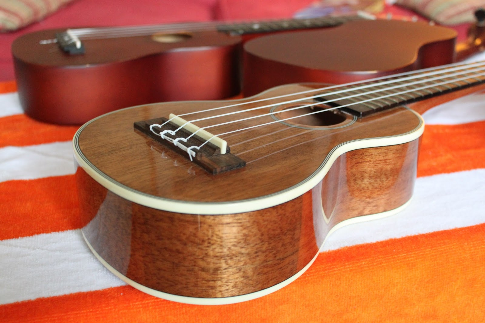 Kala Mahogany Long Neck Glossy (front). This is the prettiest uke in  #BD540E