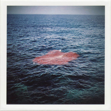 dirty photos - time - cretan landscape photo of red circle in the sea