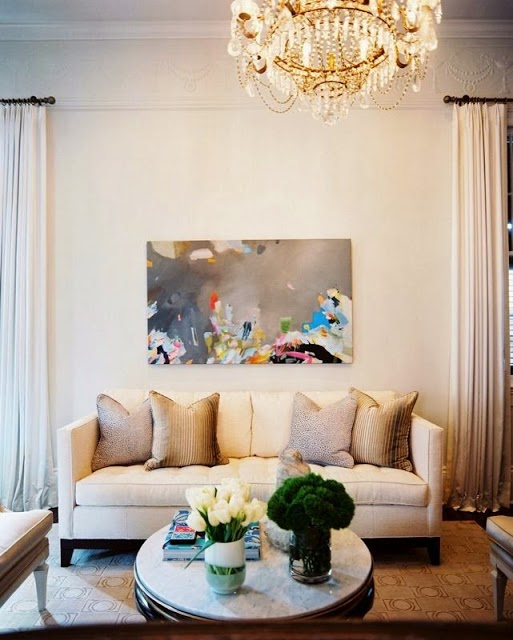 beautiful light bright traditional style white living room modern art
