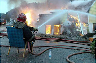 funny picture: fireman extinguishes fire sitting
