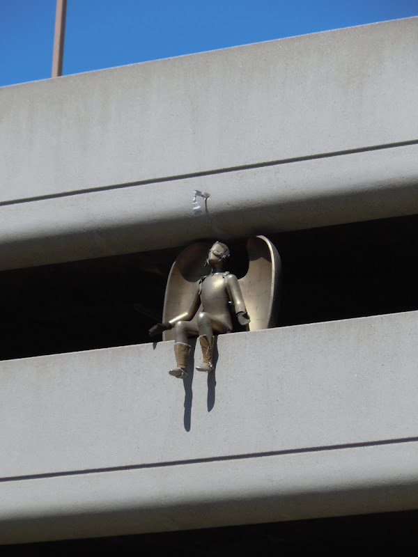 Sitting angel sculpture San Vicente Blvd
