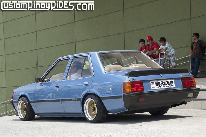 blue Mitsubishi Lancer EX, gold rims, klasyczne, japońska motoryzacja, galeria