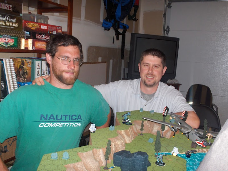 "Aaron and myself at one of our ""HUGE"" Heroclix games."