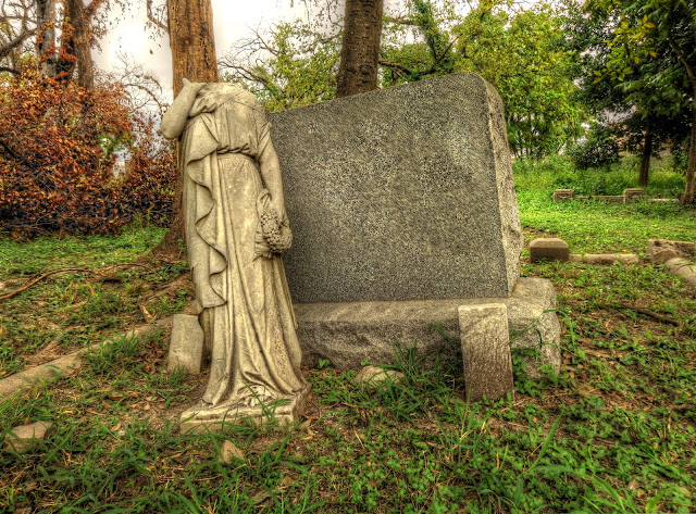 Olivewood Cemetery Headless statue and head stone - Houston, Texas