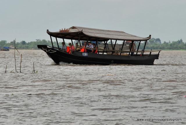 La vie quotidienne en marché flottant Cai Be - Photo An Bui