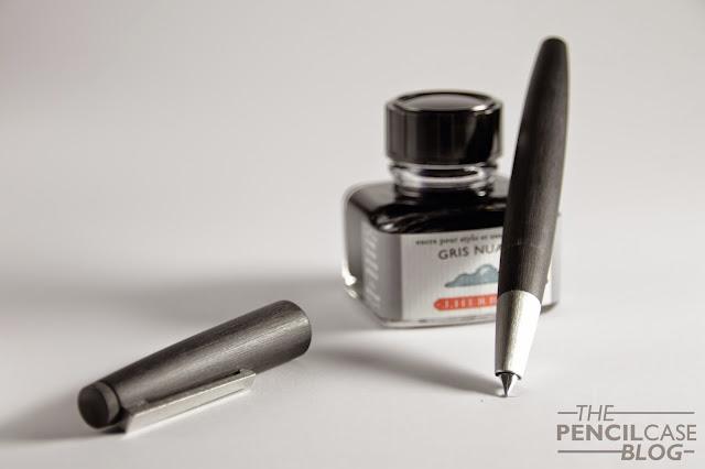 Lamy 2000 fountain pen on a bottle of J.Herbin Gris Nuage ink
