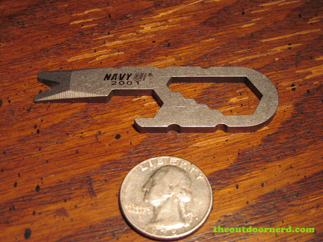 Navy CUI 2001 Keychain Tool shown with quarter for scale