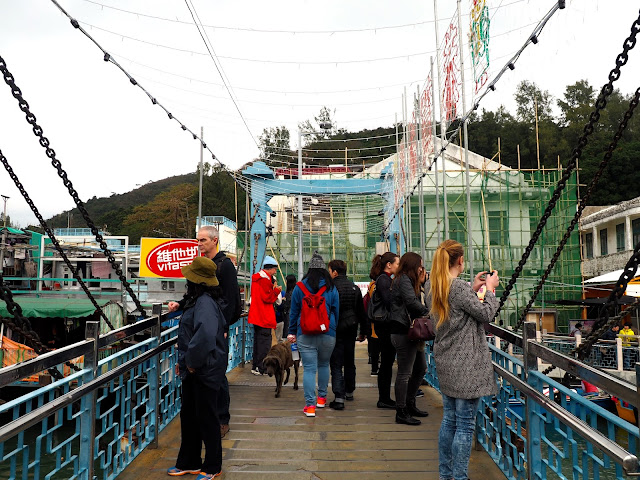 Bridge full of people, crossing the water in Tai O fishing village, Lantau Island, Hong Kong