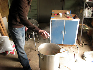 Luke adding the last dose of hops to the Styrian Bitter.