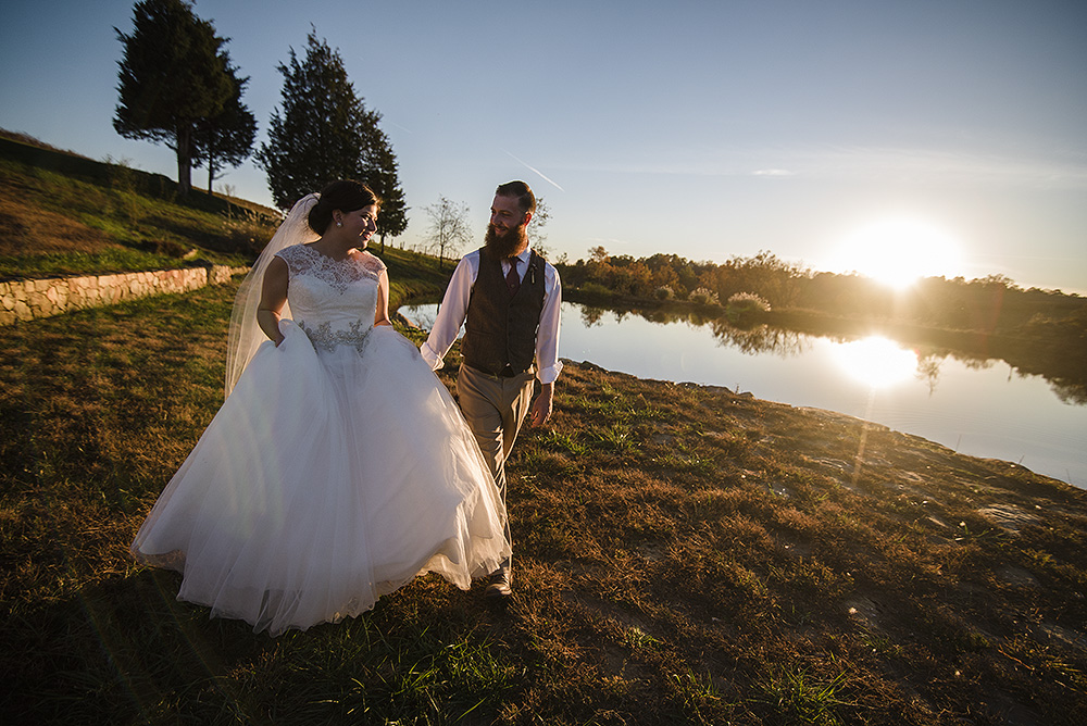 gorgeous sunset portraits of the bride and groom at Stone Tower Winery in Leesburg