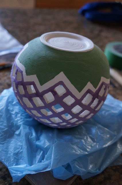 Pierced clay ceramic candle holder vessel in progress.
