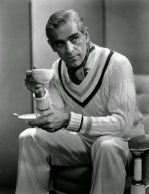 Boris Karloff having his coffee.