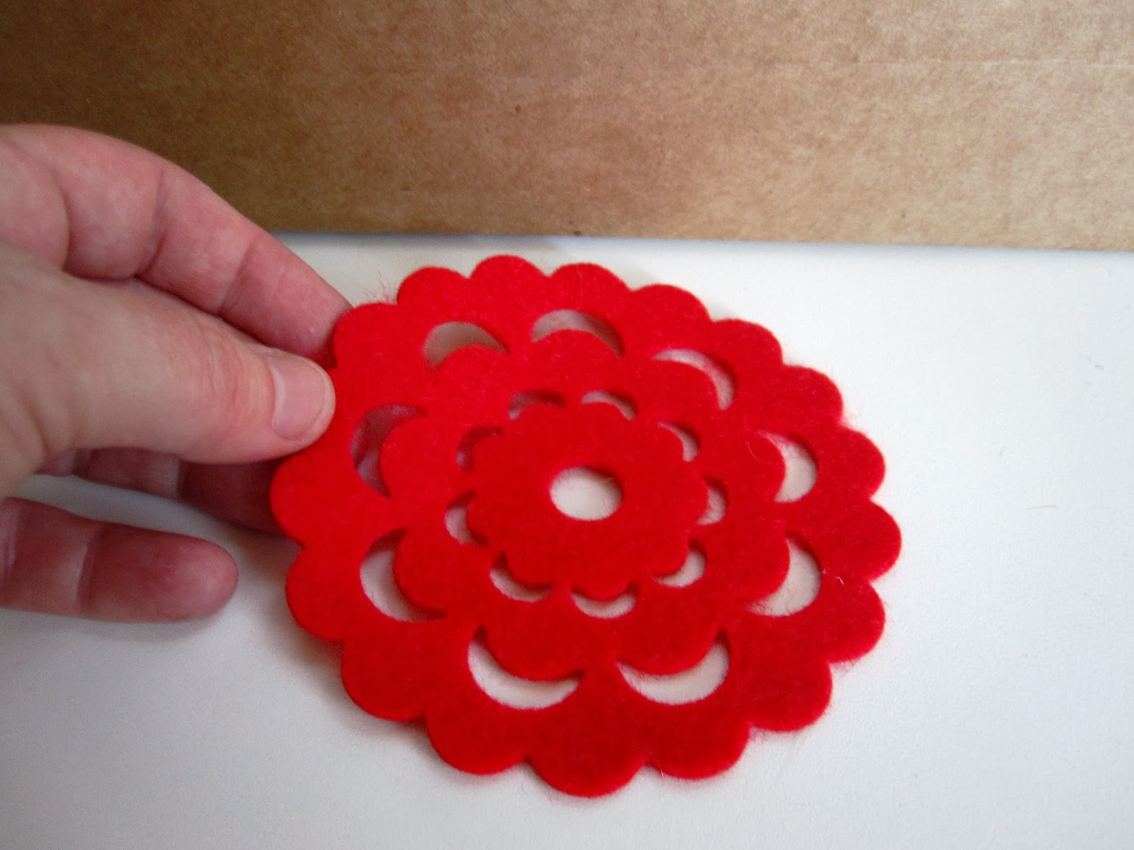 Red felt doily coaster, for use as a modern miniature rug