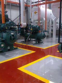 Epoxy floor coatings with chemical resistant urethane topcoat.