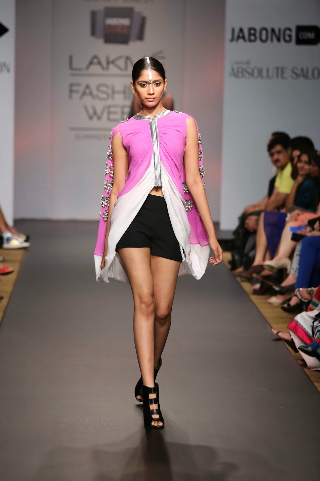 Urvashi Joneja's collection of high end casual and evening wear was a decadent display of all things feminine and feisty, at Jabong Stage during Lakmé Fashion Week Summer/Resort 2014. The designer stuck to a monochrome palette broken by pops of colours such as chalk purple and muted orange.