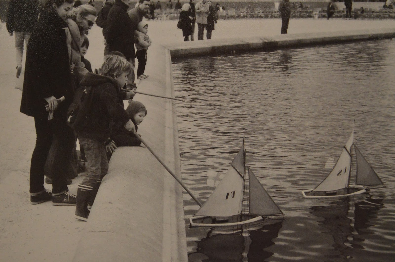 Photography: Boys sailing boats in Luxembourg gardens, Paris