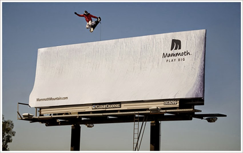 Billboard transformed to look like a ski slope, with snowboarder cut-out positioned above.