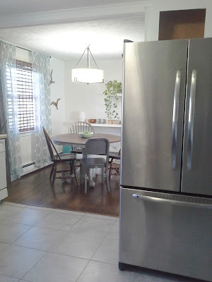 open kitchen dining room stainless steel refrigerator