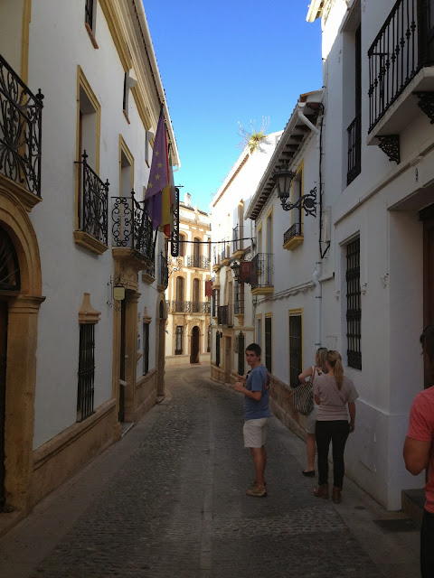 Walking down a street in Ronda on Semi-Charmed Kind of Life