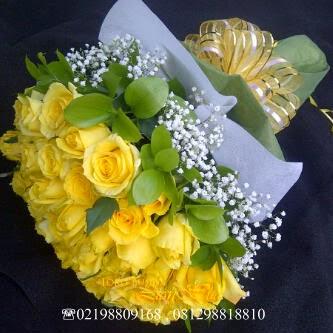 Handbouquet mawar kuning