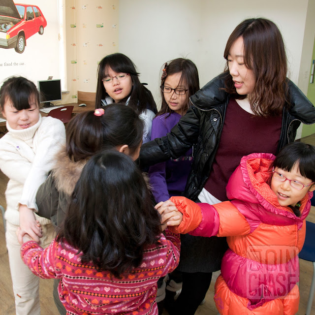 "Students playing ""Human Knot"" during Winter English Camp at Bibong Elementary in Ochang, South Korea."
