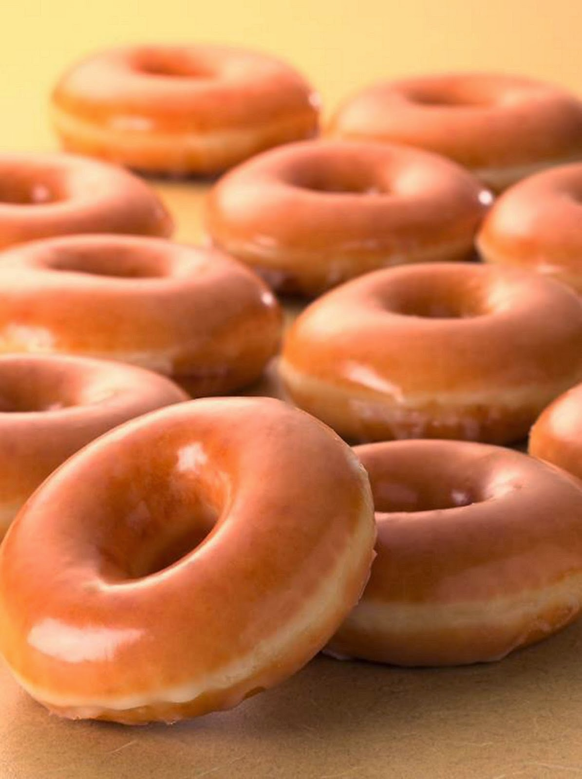 ... to a complimentary dozen original glazed doughnuts in exchange for a
