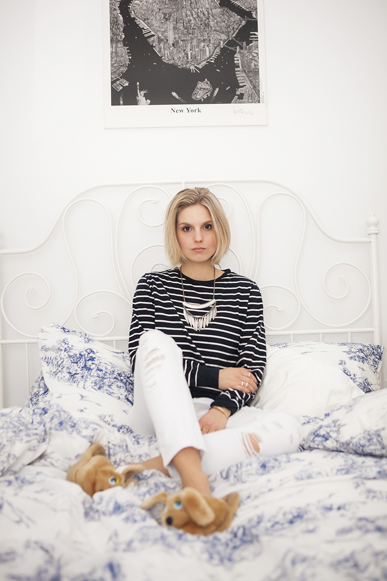 White metal wire bed frame, striped long sleeve shirt, white distressed denim