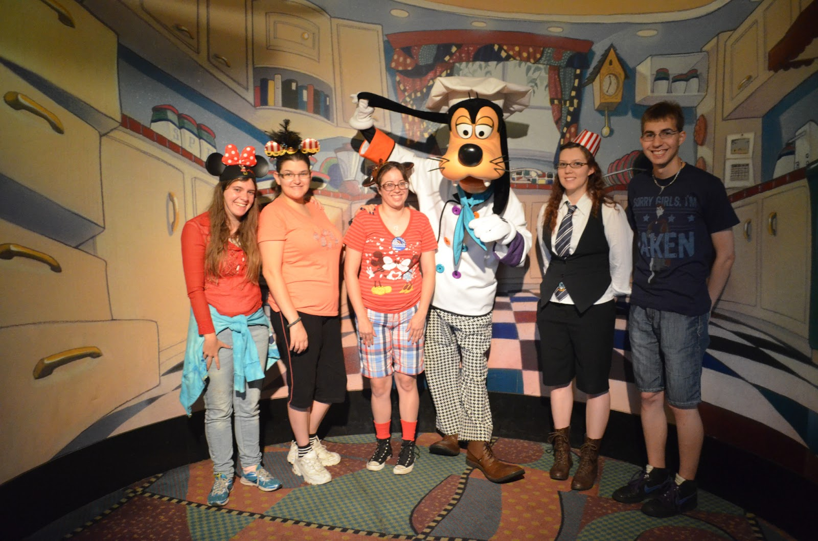 after checking in you then go in and take a picture with goofy in his chef whites before being seated our party of six was sat in a sort of secluded room - Goofys Kitchen