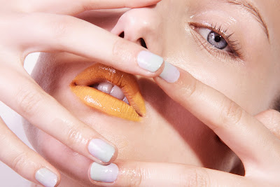 woman with yellow lipstick, dewy skin, cosmetic photography