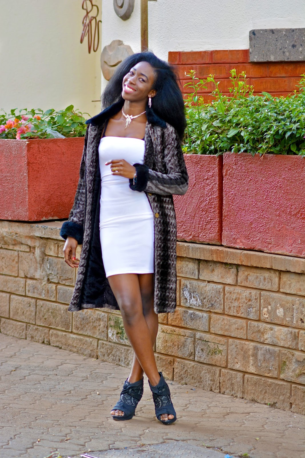 Style with Ezil, Ezil. Little white dress, how to wear a little white dress, fur coats, ankle boots, How to wear ankle boots with a dress, Simple dinner date outfit, simple elegant outfit, Kenyan fashion blogger, African Fashion blogger