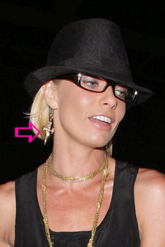 Jaime Pressly wearing gold dagger earrings by Jenny Dayco