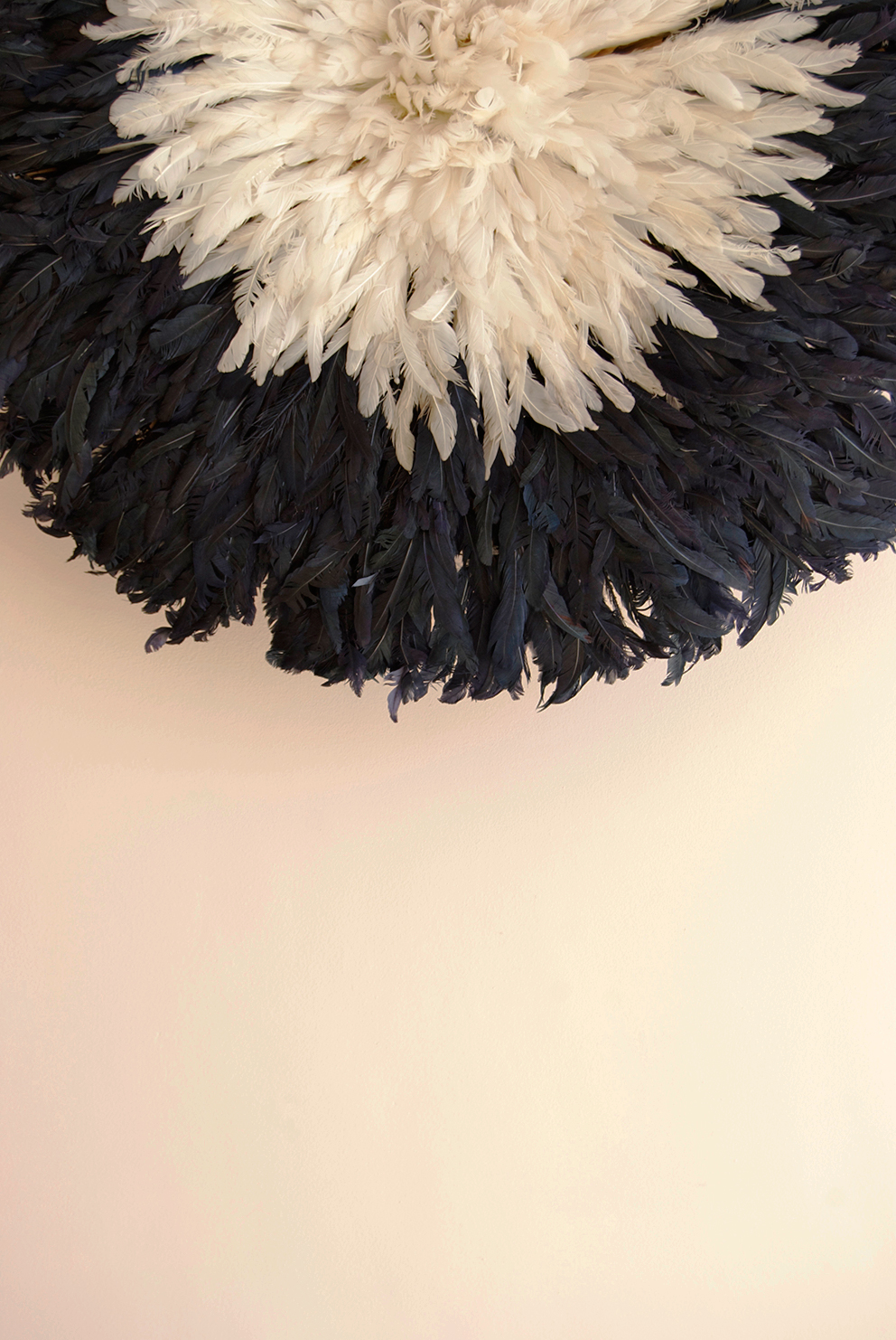 Black and cream juju hat on blush pink wall. French For Pineapple blog
