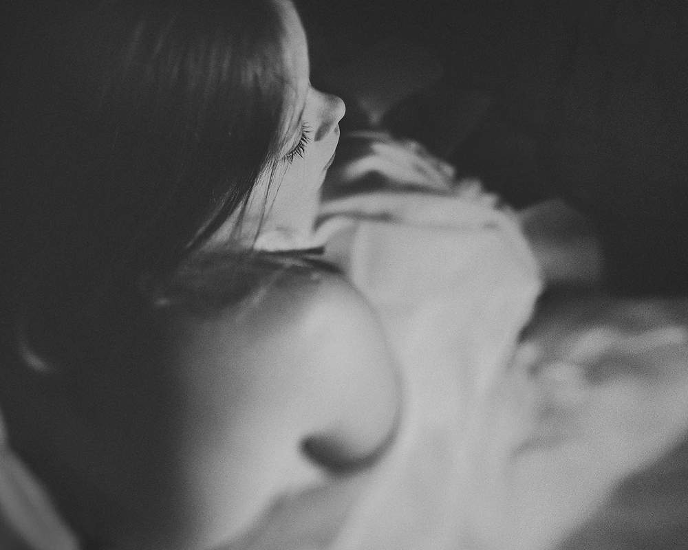 fine art black and white film portrait of a girl captured with a tilt shift lens