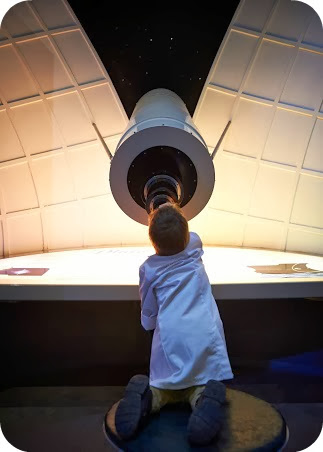 Small Boy stargazing at the National Space Centre Leicester