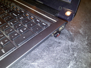 Shows flash drive installed in USB port of laptop computer