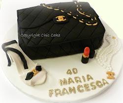 torta Chanel bianca, nero e oro