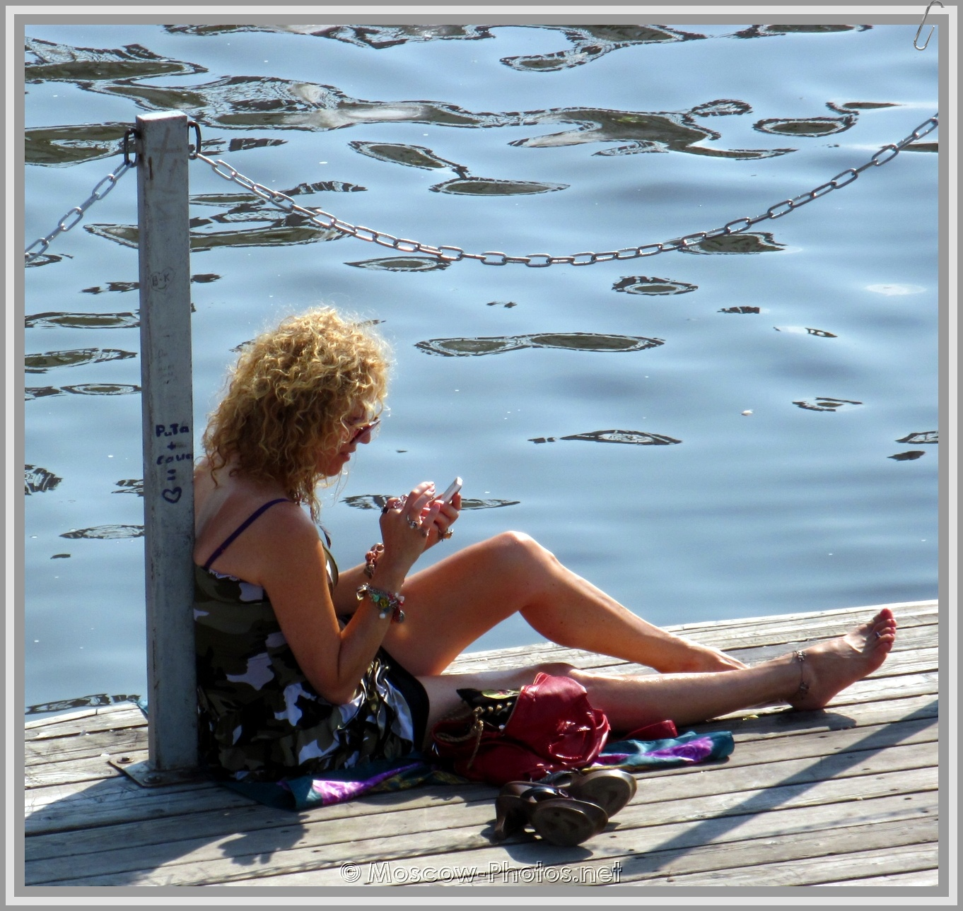 Girl With Phone Near River