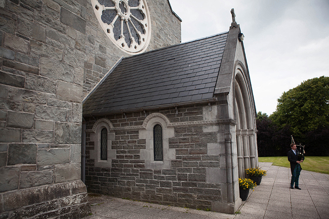 Wedding Photography Doonbeg Ireland, bagpiper at church