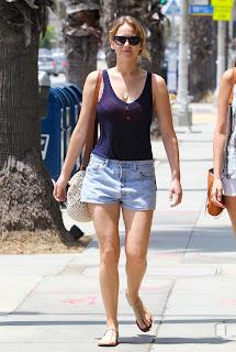 Jennifer Lawrence in short denim shorts and a blue tank