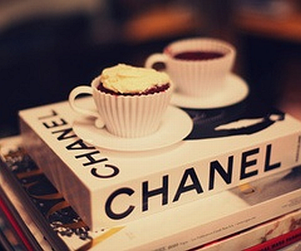 cup of coffee with Chanel and fashion books