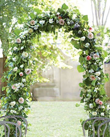 vines woven around a Tuscan Wedding iron arbor hayneedlecom