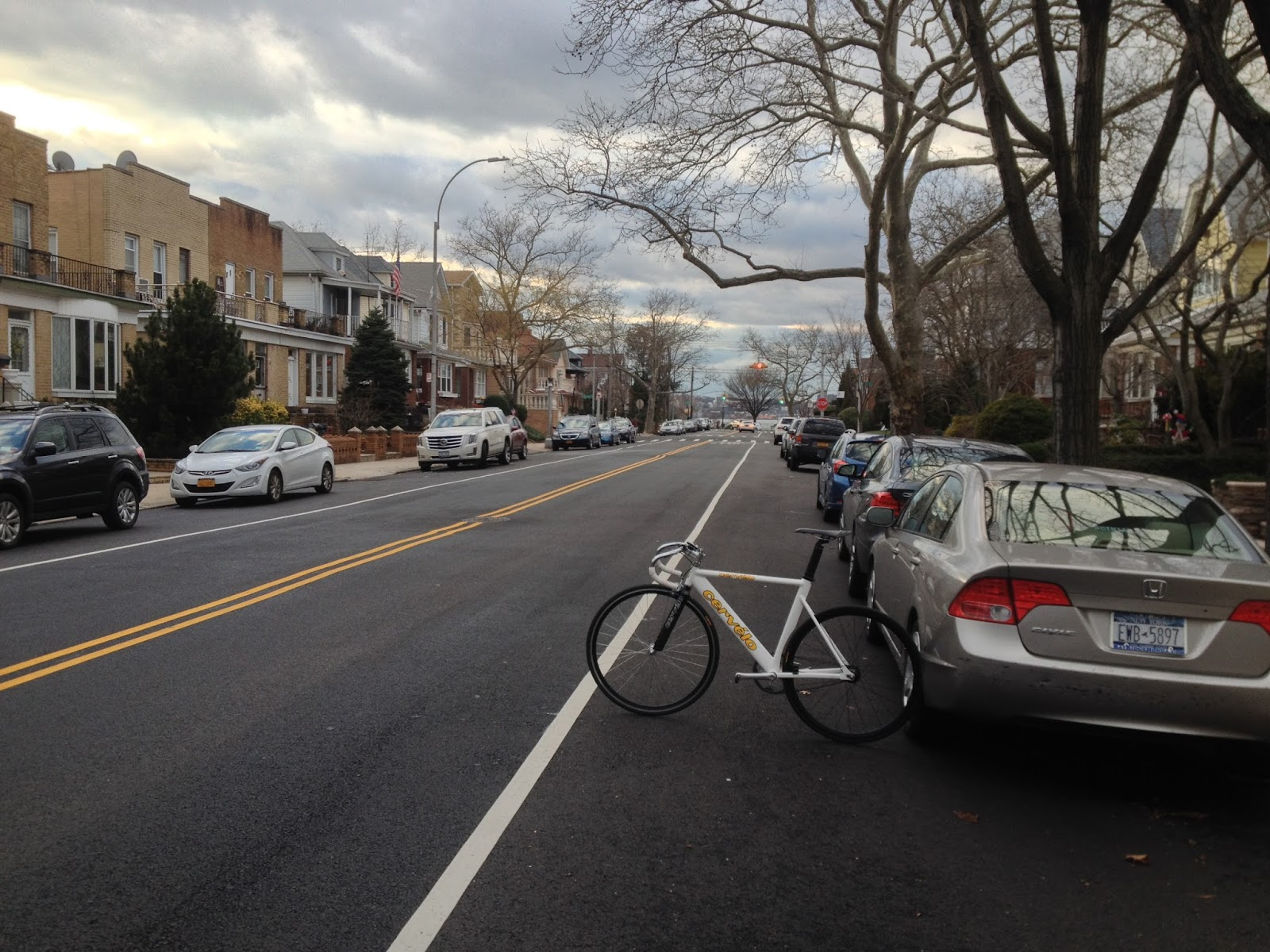 bay ridge parkway s new stripe with parked car and bicycle