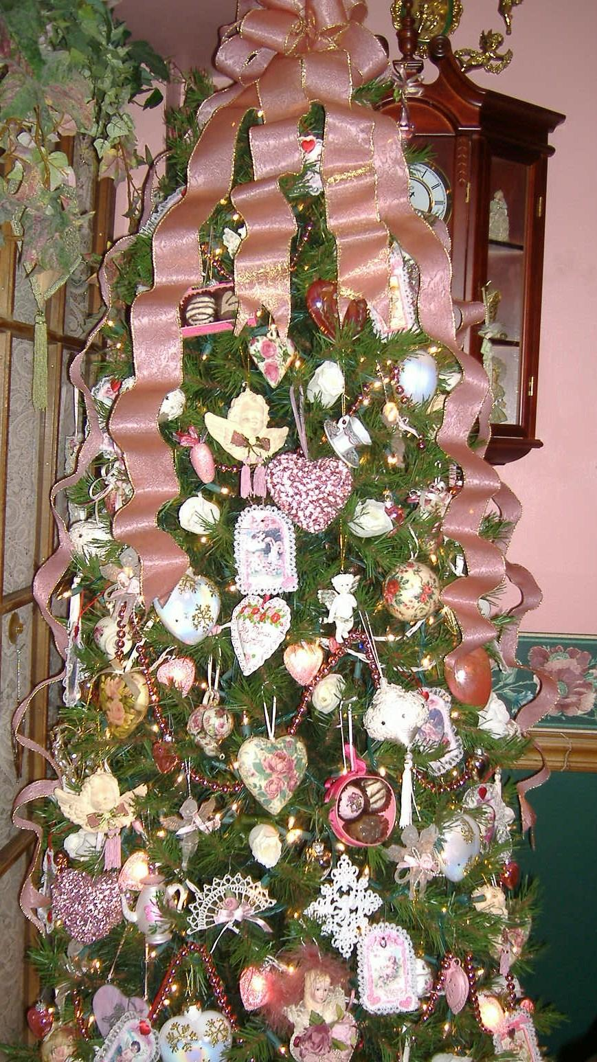 I Set Up A Small White Feather Tree Adorned With Silver Pink And Gold Hearts