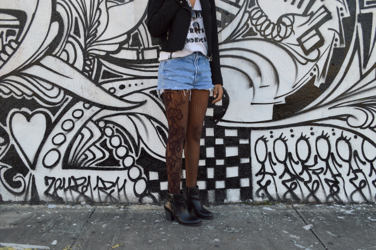 Fashion Blogger Anais Alexandre of Down to Stars in a Forever 21 motorcycle jacket with Obesity and Speed tank, vintage denim shorts and Marc Fisher boots