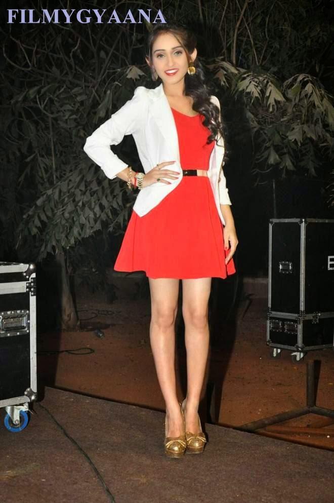 tanya sharma looks hot in white jacket and red mini dress wallpaper