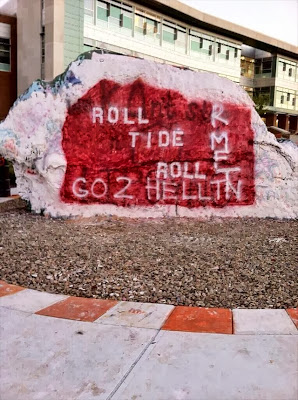 Roll Tide Roll painted on University of Tennessee's The Rock.