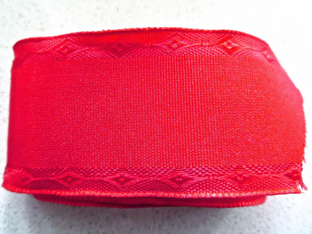 Red wire grosgrain ribbon with an embossed pattern